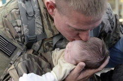 soldier-holding-baby
